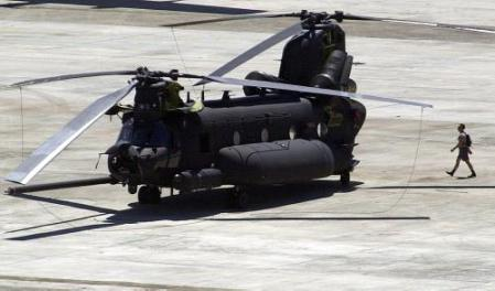 A member of the Mactan Air Force Base ground crew walks behind one the two remaining MH-47E Chinook helicopters.