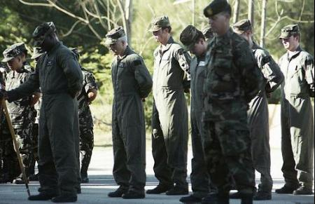 Members of the E Company, 160th Special Operations Aviation Regiment pay thier respects to fallen comrades.