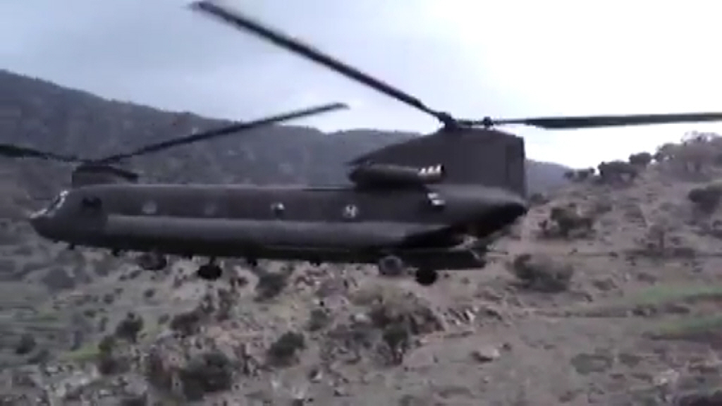 View the Video: An unknown CH-47D Chinook helicopter extracts grounds troops at an unknown location.